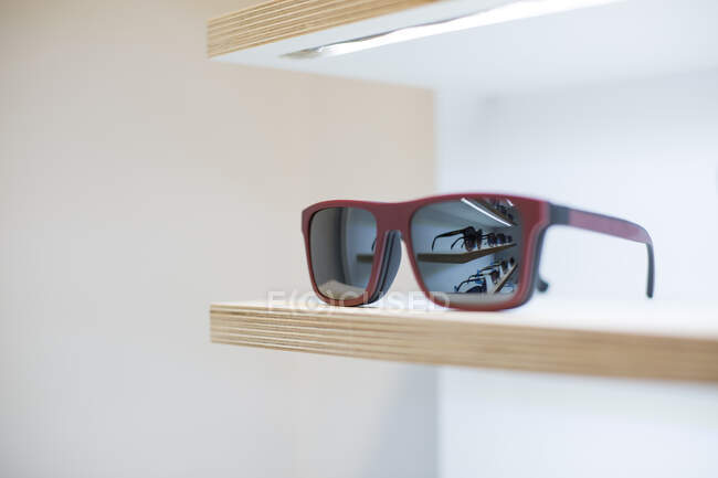 Sunglasses on a shelf in a store — Stock Photo