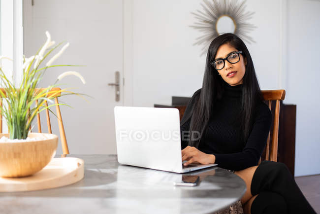 Businesswoman working from home on her computer — Stock Photo