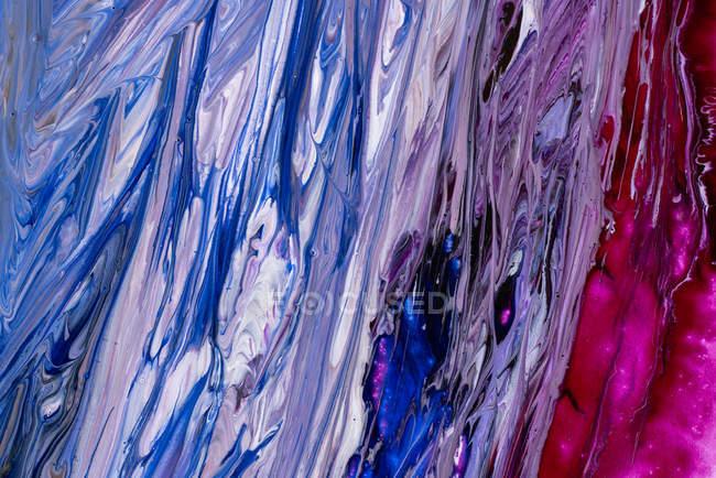 Abstração de tintas líquidas no fluxo de mistura lento que mistura junto — Fotografia de Stock