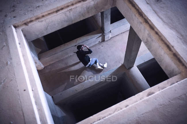 Anonymous man dancing in shabby building, high angle view — Stock Photo