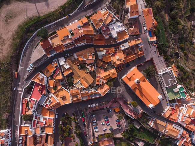Aerial view of small town of Tejeda in valley and rocky mountains in sunlight, Gran Canaria — Stock Photo