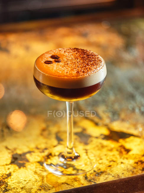 Glass with chocolate alcohol cocktail on bright blurred background — Stock Photo