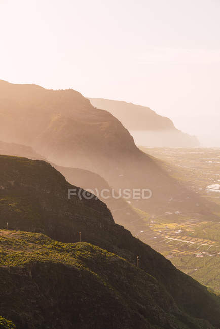 View of green valley with village near hills and water in Tenerife, Canary Islands, Spain — Stock Photo