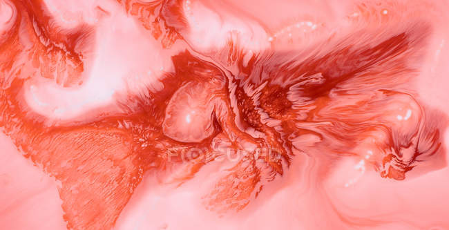 Abstraction of liquid paints in slow blending flow mixing together gently — Stock Photo
