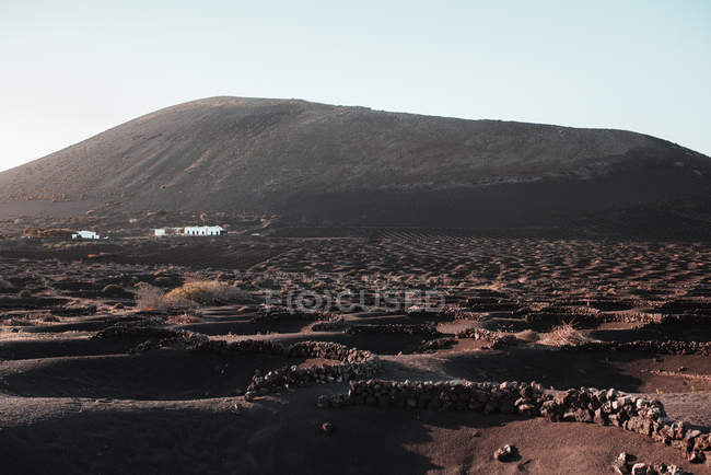 Picturesque view of barren lands between and near in Lanzarote, Canary Islands, Spain — Stock Photo