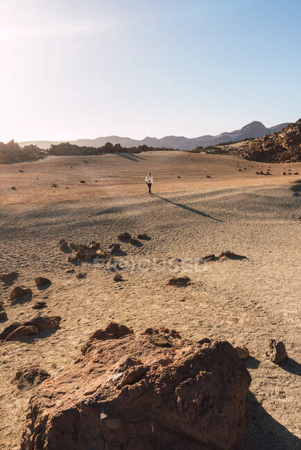 Silhouette of person on sand land near mountain Teide and picturesque view of blue heaven in Tenerife, Canary Islands, Spain — Stock Photo