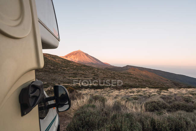 Camper van on land near picturesque peak of mountain Teide at sunset in Tenerife, Canary Islands, Spain — Stock Photo