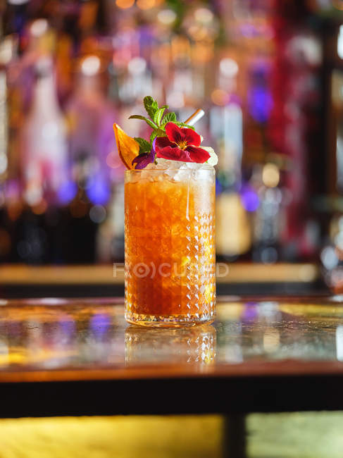 Cocktail decorated with fruits and flower — Stock Photo