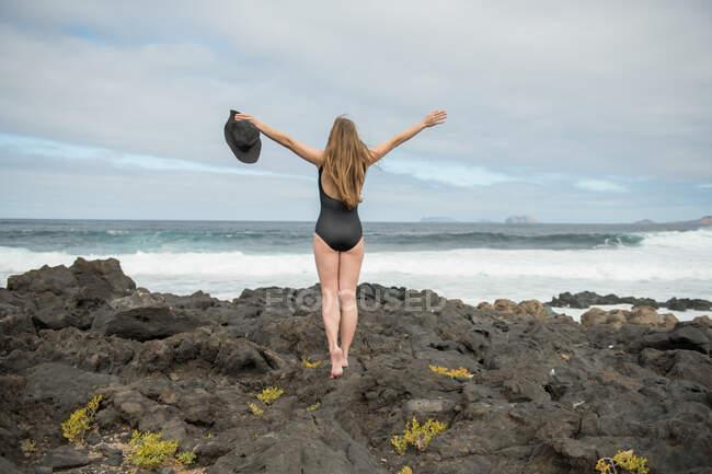 Sensual female near stormy sea — стоковое фото