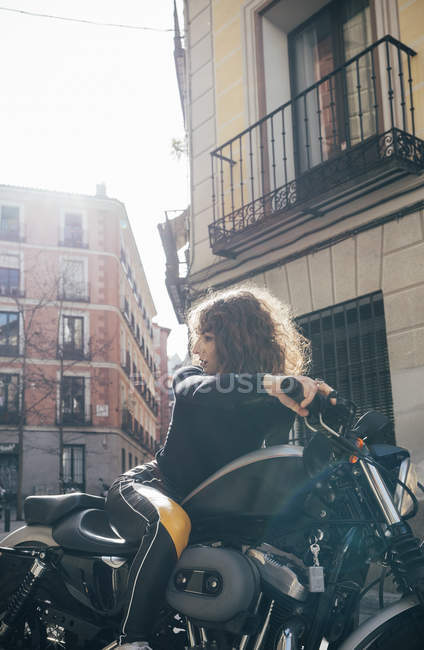 Young woman in custom motorbike — Stock Photo
