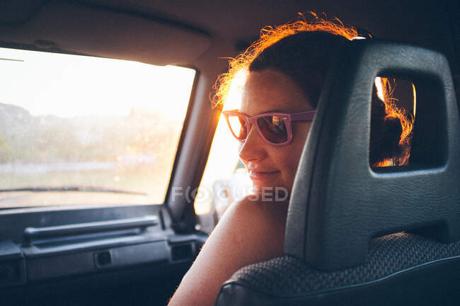 Young woman traveling in car — Stock Photo
