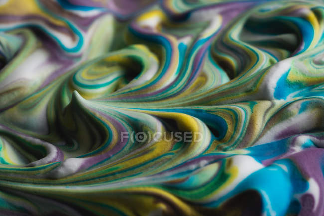 Abstract multicolored shaving cream on white canvas — Stock Photo