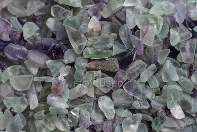 From above small raw fluorite rocks placed in pile — стоковое фото