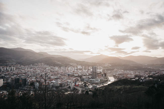 Magnificent cloudy sky over modern city of Bilbao from hill during dull morning in Spain — Stock Photo
