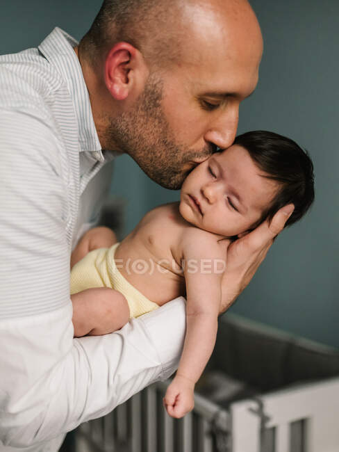 Father hugging cute baby — Stock Photo