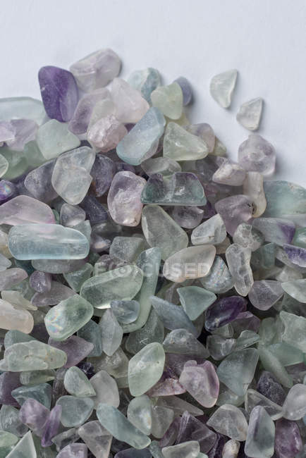 From above small raw fluorite rocks placed in pile in pile on white background — Foto stock