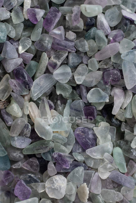 From above small raw fluorite rocks placed in pile — Stock Photo