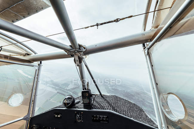 Aerial view from inside the cockpit of a small plane — стокове фото