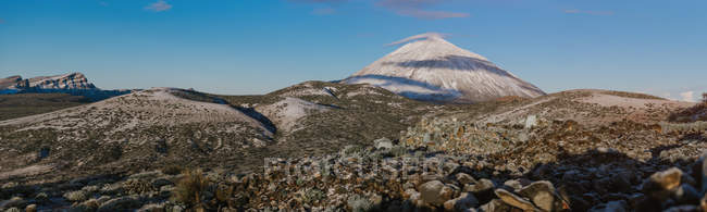 Panoramic view of snowy mountain peak against blue sky on Canary Islands, Spain — Stock Photo