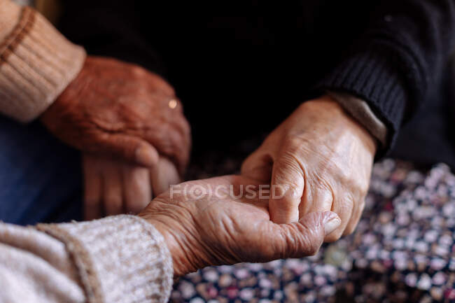 Detail of the wrinkled hands of an elderly couple — Stock Photo