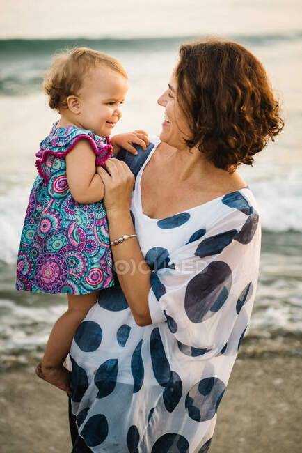 Mother holding a little child — Stock Photo