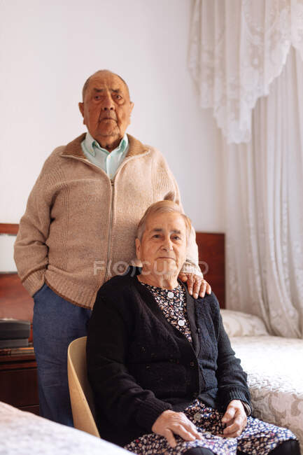 Portrait of an elderly couple in their home interior — Stock Photo