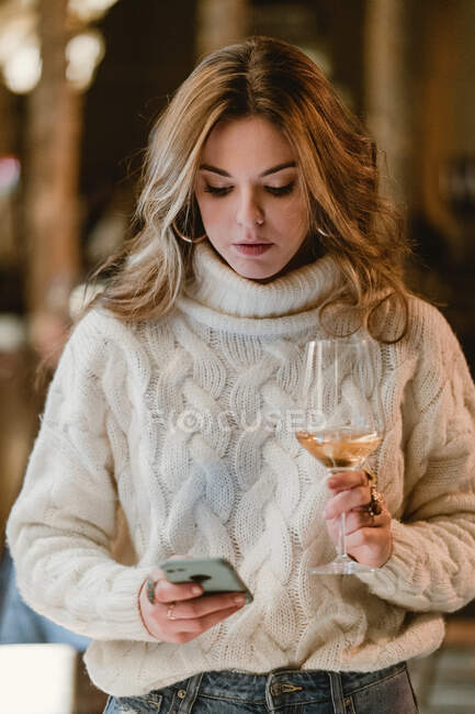 Stylish woman drinking wine in bar — Stock Photo