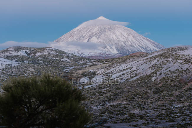 View of snowy mountain peak against blue sky at dusk on Canary Islands, Spain — Stock Photo