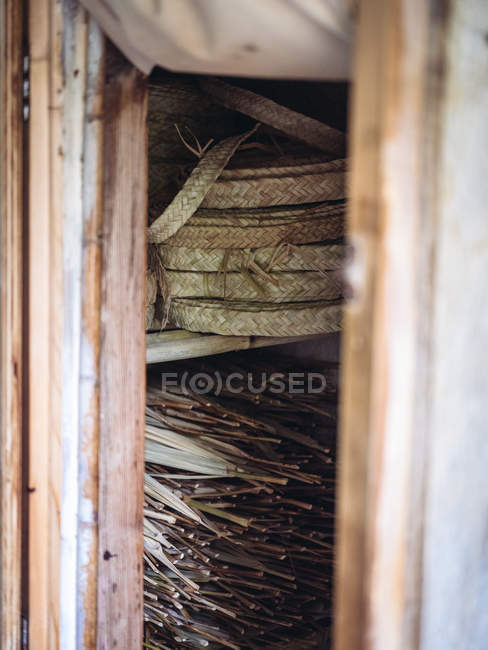 Set of rolls of woven dried palm fiber in workshop — Stock Photo