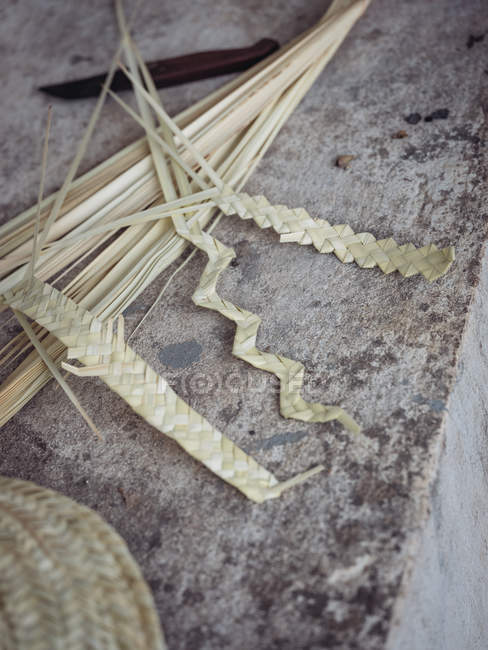 Breaded dried palm leaves fiber on grey grunge surface — Stock Photo