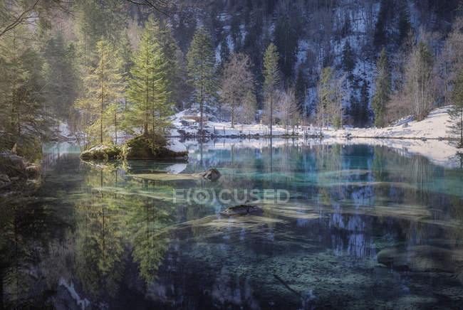 Landscape of peaceful azure lake with snowy shore in mountains of Switzerland — Stock Photo