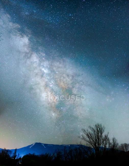 Wild landscape under bright night sky with Milky way — Stock Photo