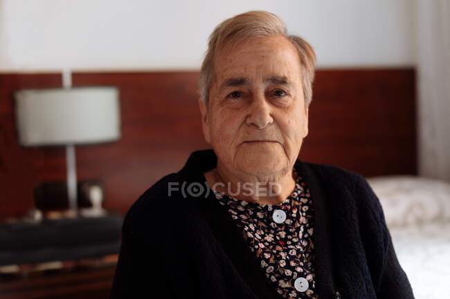 Portrait of elderly woman with Alzheimer's. — Stock Photo