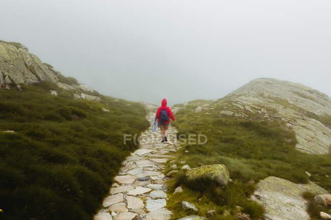 Anonymous female on stony hill — Stock Photo