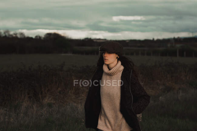 Young woman in warm clothes in forest — Stock Photo