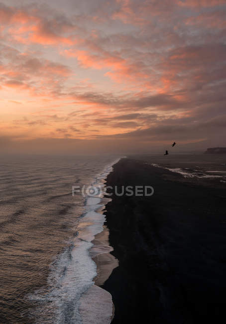 View of beach near cape Dyrholaey at sunset — Stock Photo