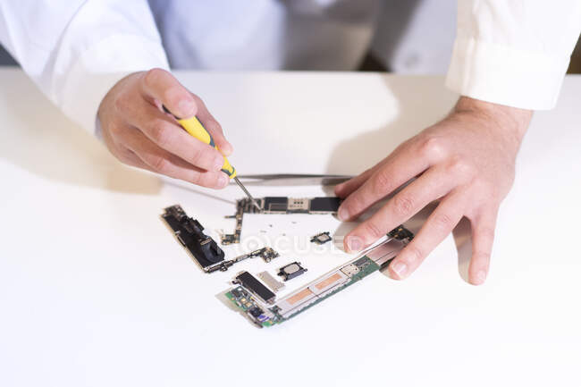 Young man repairing modern device — Stock Photo