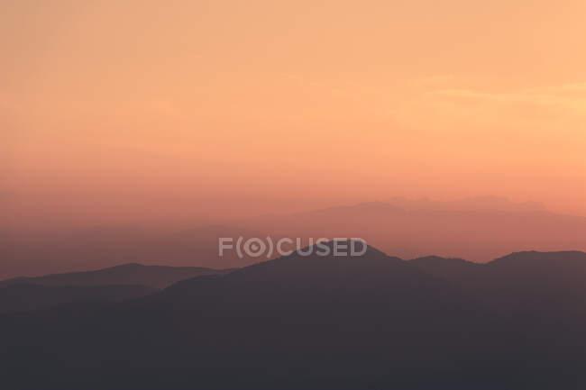 Sunset sky over mountain ridge — Stock Photo