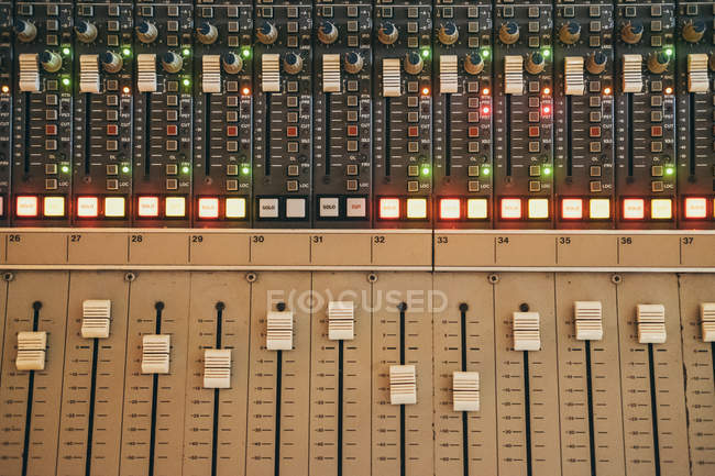 Close up of music equalizer instrument in studio — Stock Photo