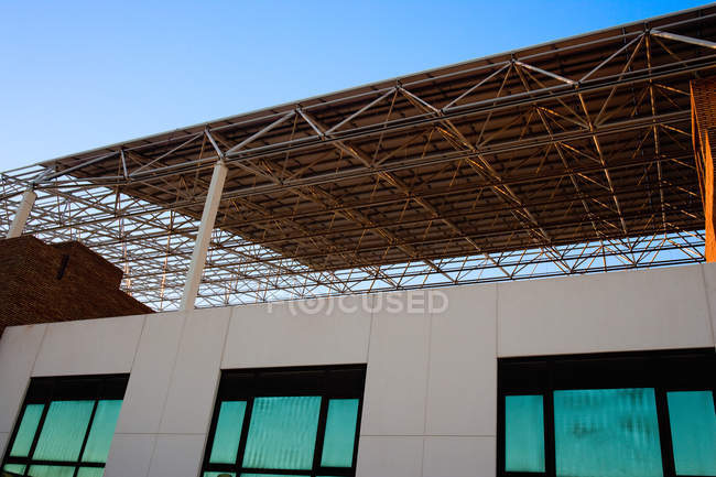 Building with roof made of solar panels — Stock Photo