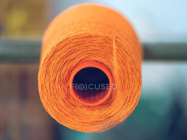 Spool of thread on weaver loom on factory — Stock Photo