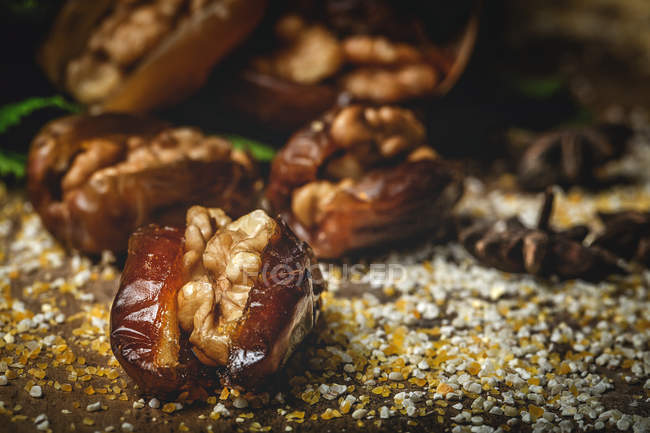 Closeup of halal snack for Ramadan with dried dates and walnuts — Stock Photo