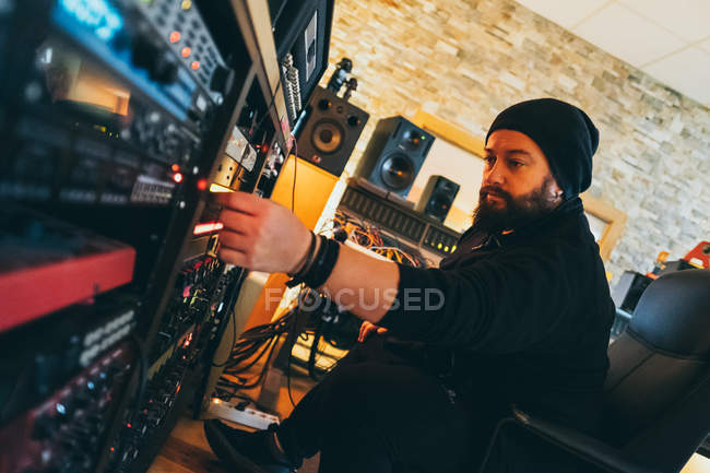 Musician working with stereo control in studio — Stock Photo