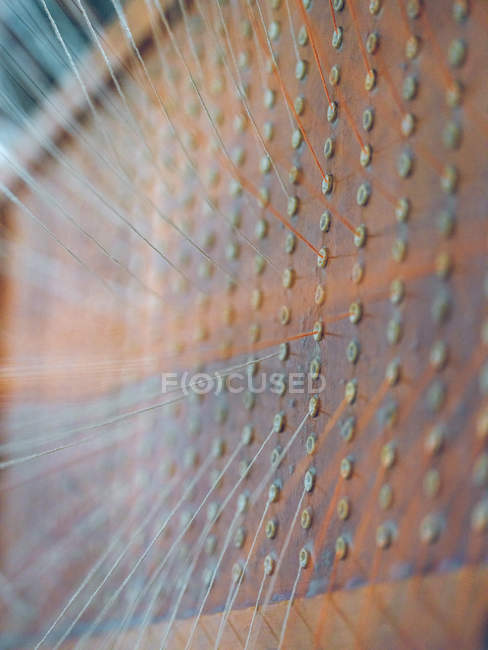 Close-up of white and orange threads on loom — Stock Photo