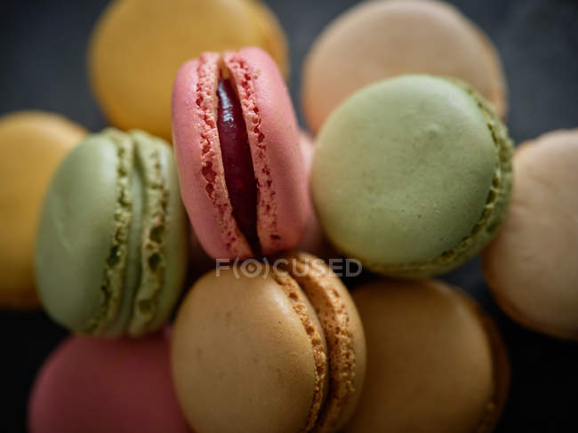 Colorful fresh tasty macaron biscuits in heap — Stock Photo