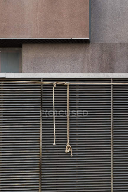 Closed shutters located outside contemporary building on city street — Stock Photo