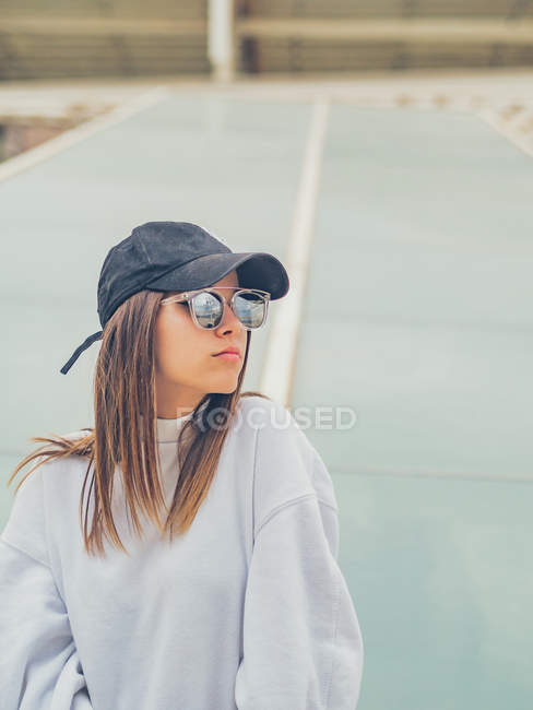 Young modern female hipster in casual clothes looking away — Stock Photo