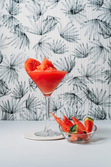Fresh watermelon Daiquiri, refreshing cocktail in glass cup on light background — Stock Photo