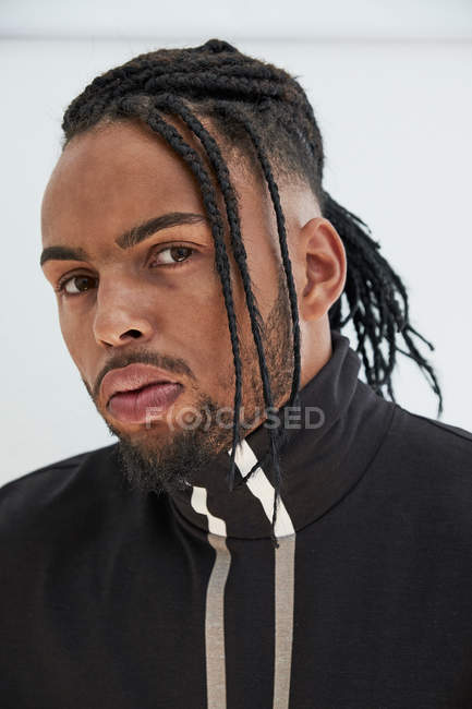 Portrait of African American man with braids on white background — Stock Photo