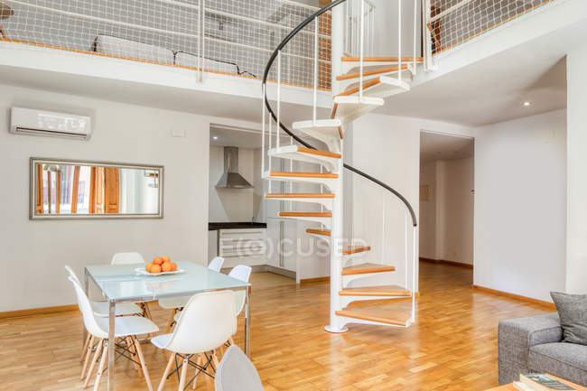 Interior stylish dining room and stairs in large modern duplex apartment in daylight — Stock Photo